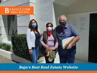 Claudia with satisfied clients from rosarito beach condo hotel