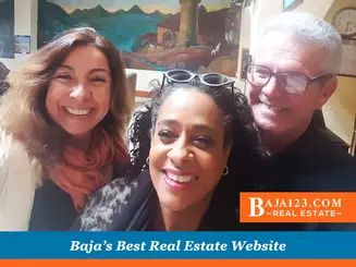 Happy buyers with Claudia Pierce in costa bella